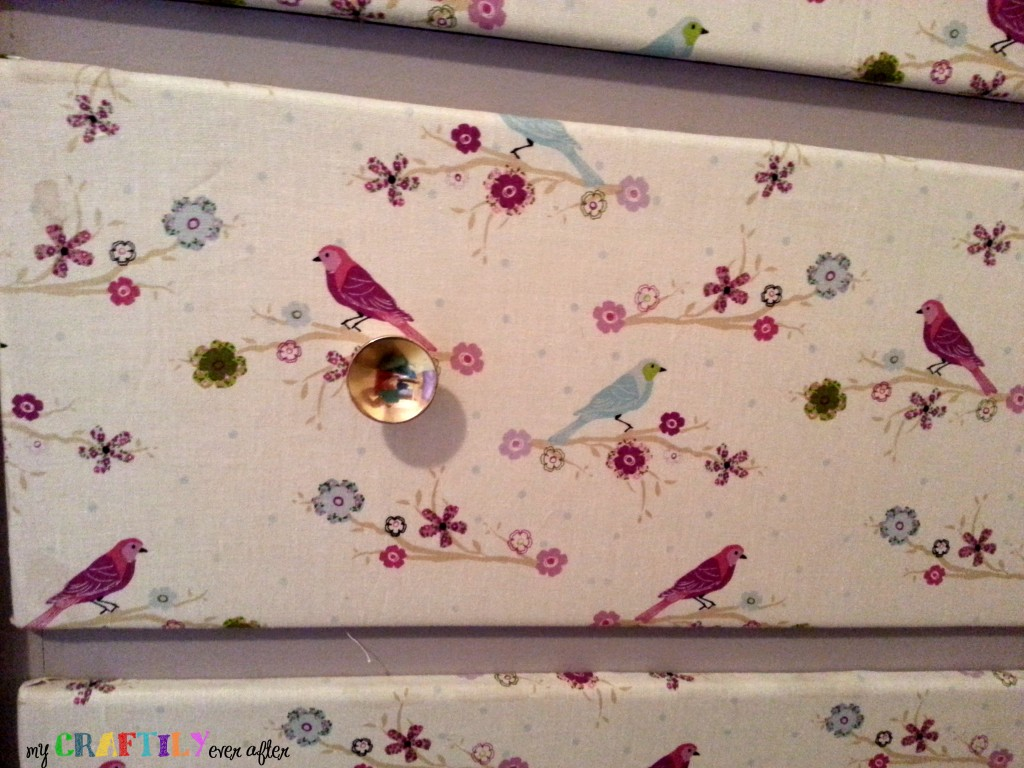 fabric covered dresser drawers close up