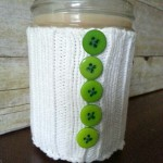 Turn an old sweater into a cup cozy using items you already have at!  It only takes two steps to create this one of a kind gift sure to please the coffee drinker in your life!  Get all the details at My Craftily Ever After