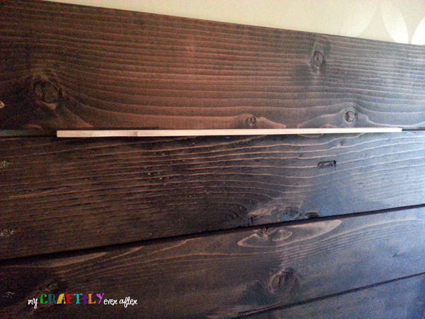 planked headboard using paint stir sticks as spacers