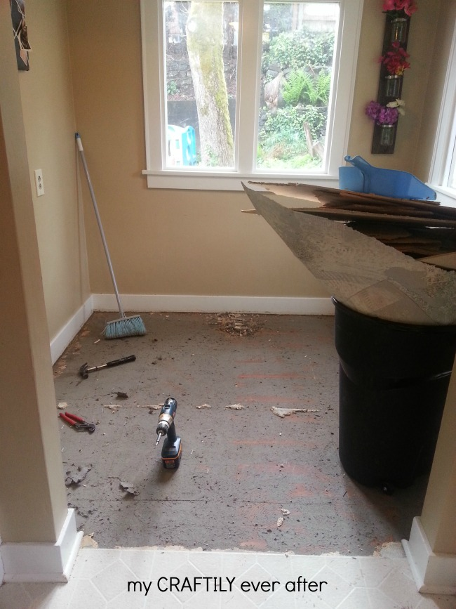 removing the plywood under the linoleum in a kitchen floow