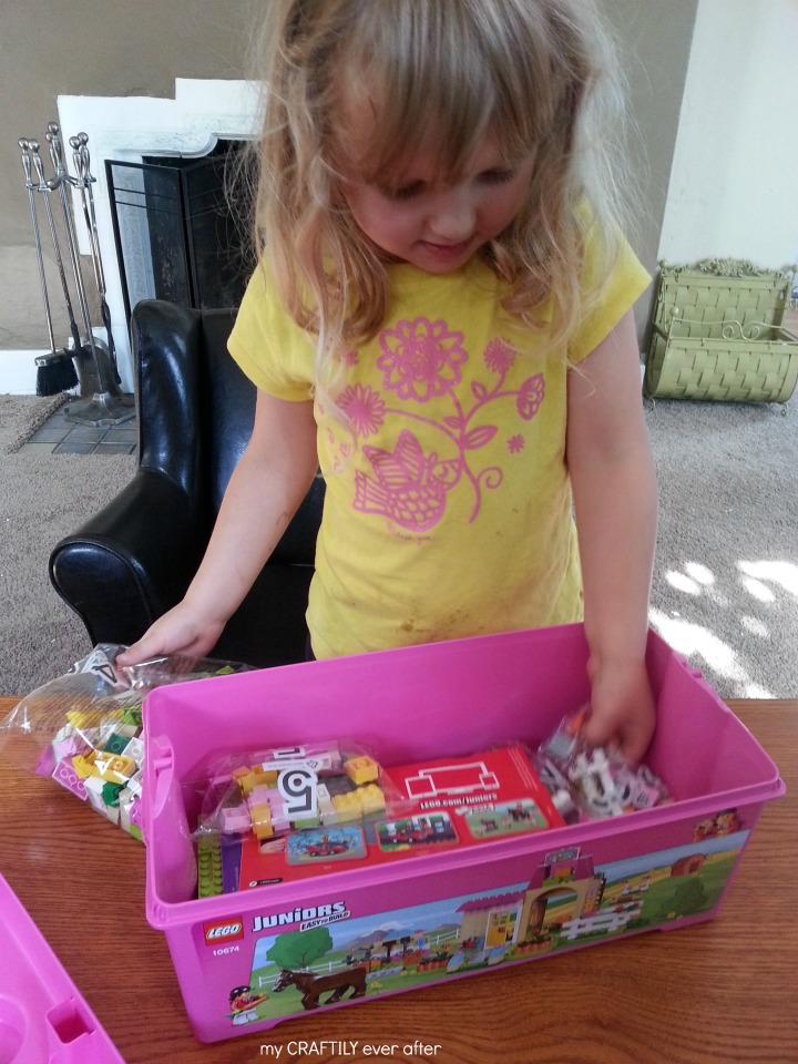 opening up her LEGO juniors