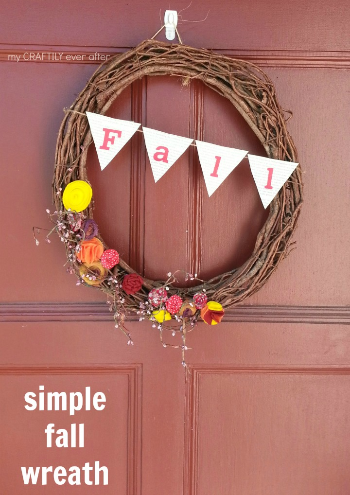 simple fall wreath on the front door