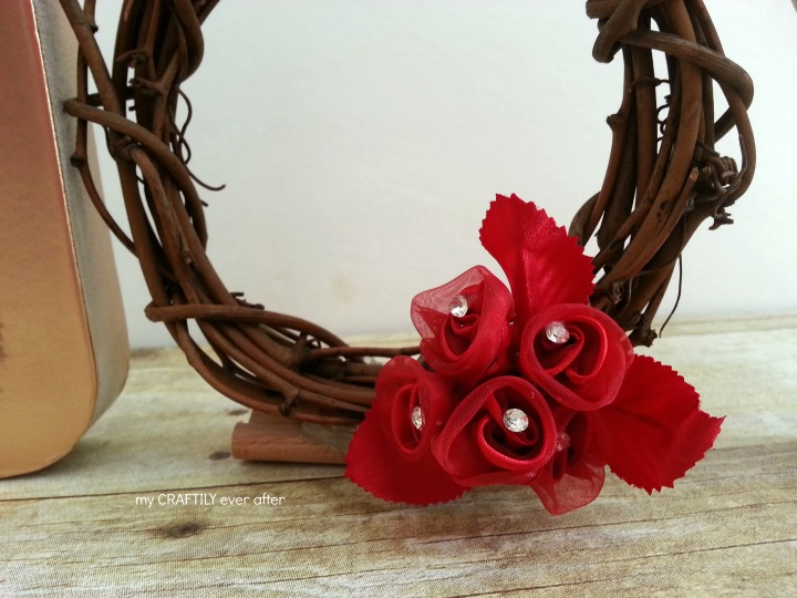 hot glued flowers to small wreath