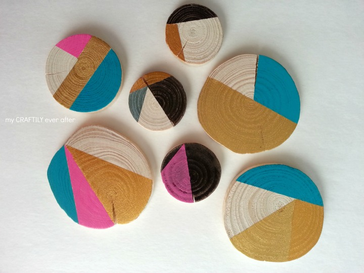 ornaments made from wood slices with paint