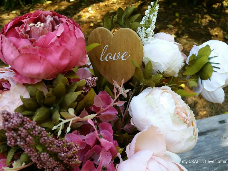 rustic floral arrangement with stained heart